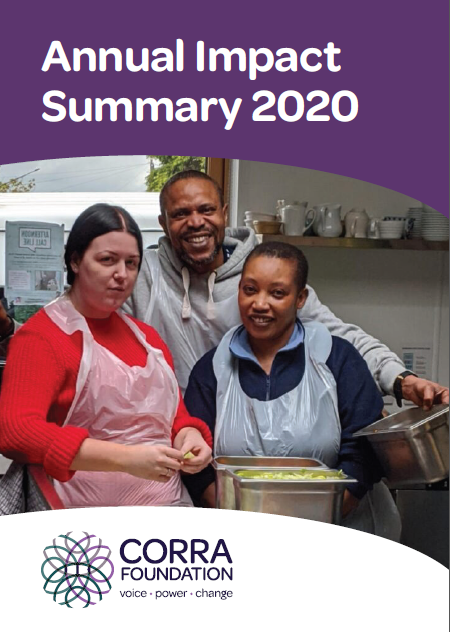 Image showing three people smiling in kitchen with plastic aprons