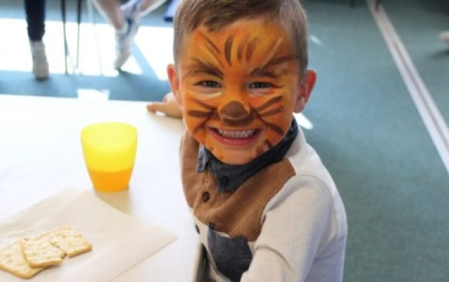 Child smiling in facepaint